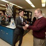 Johns Hopkins University President Ronald J. Daniels (left) presents the President's Frontier Award to Scott Bailey.